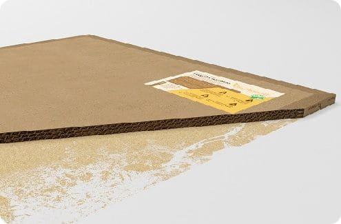 Крафт-картон с вощёной бумагой и волокнами дерева.