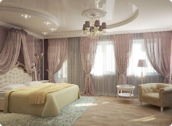 Двухуровневый натяжной потолок в спальне.