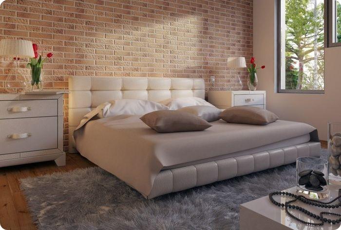 Кирпичная кладка смотрится довольно романтично в области, где изголовье кровати примыкает к стене..