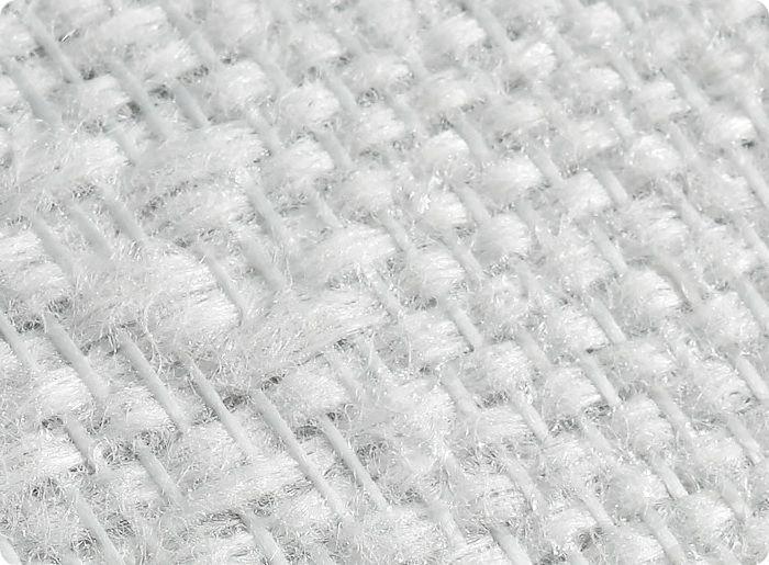 Специальное стекло нагревают до 1200ºС, затем из него вытягивают волокна и формируют пряжу. Материал вяжут из стеклонитей разной толщины и плотности. Для дальнейшего поддержания формы полотно пропитывают раствором на основе крахмала.