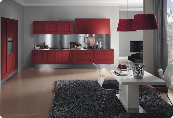 В просторных кухнях нет необходимости ограничивать свои дизайнерские идеи только красной люстрой, фасадом мебели либо настенными часами.