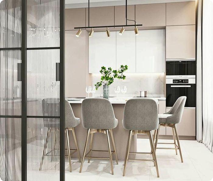 Зонирование стеклянной перегородкой кухни-гостиной.