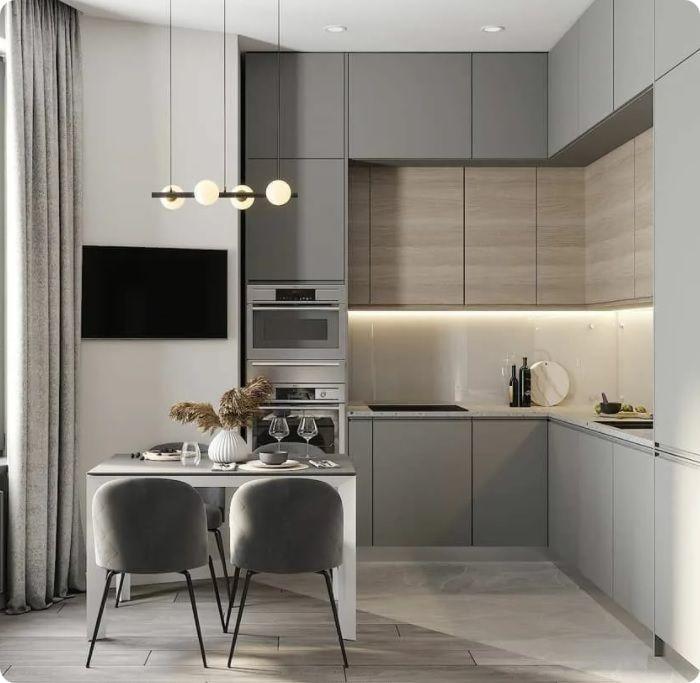 Духовка или микроволновая печь встраиваются в пенал вблизи холодильника либо с противоположной стороны.