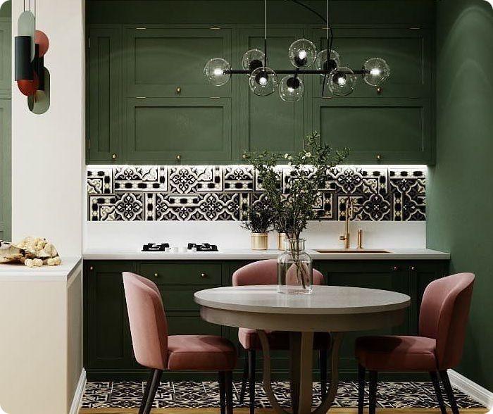 Кухня в зелёных тонах с припыленным розовым.