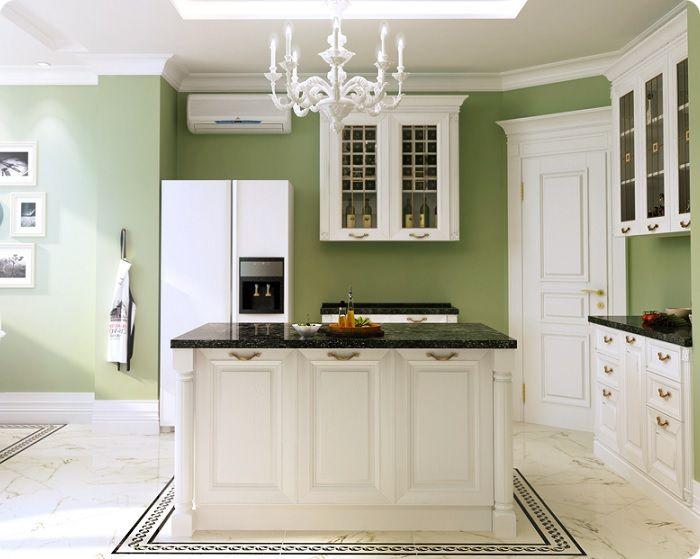 Кухня в зелёных тонах с белой мебелью.