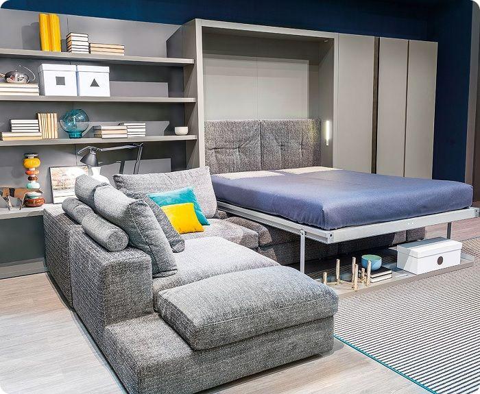 Функциональная мебель-трансформер в интерьере гостиной.
