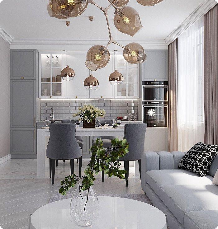 Кухня в светлых тонах, совмещённая с гостиной.