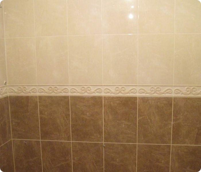 Обшивка ванной комнаты плиткой.