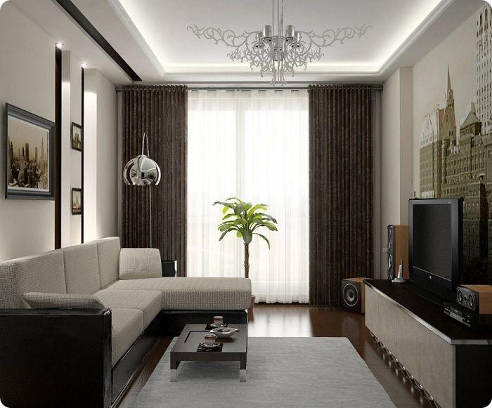 Правильное расположение углового дивана делает комнату визуально шире.