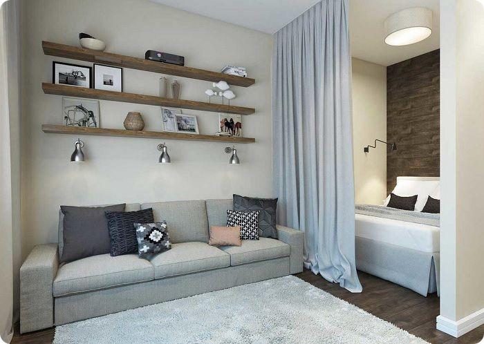 Зонирование в спальне-гостиной при помощи штор.