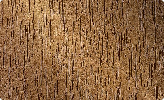 Фактурная штукатурка своим видом может скрыть недостатки поверхности стены.