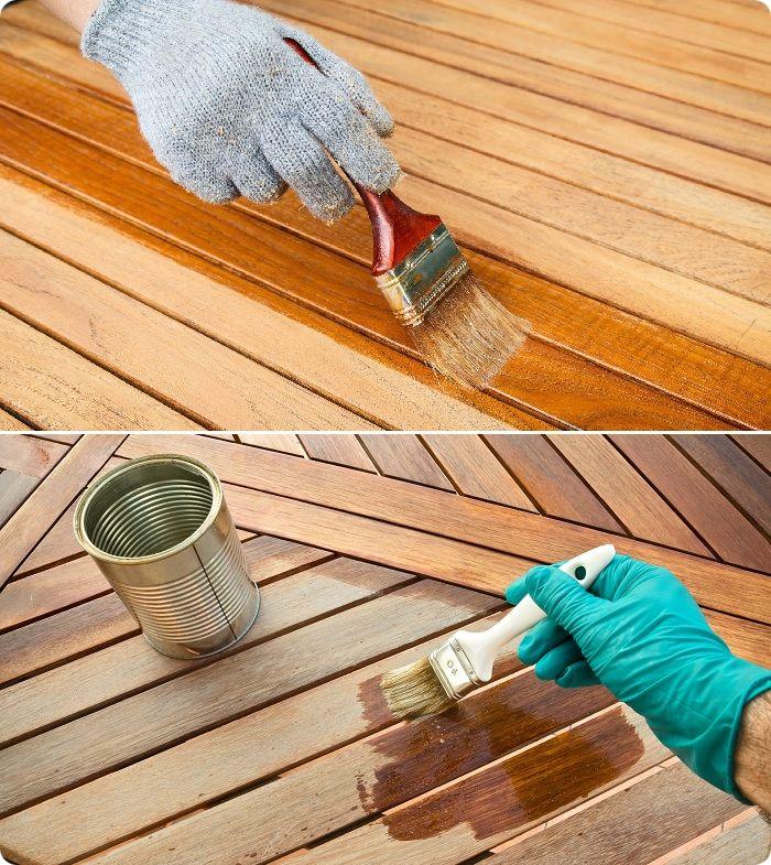 Нанесение антисептика на деревянную поверхность.
