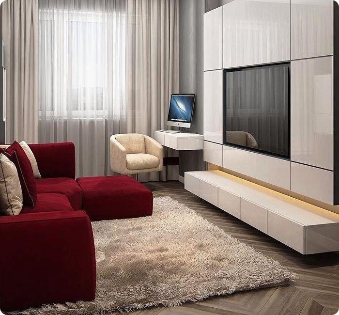 Красный диван в интерьере гостиной.