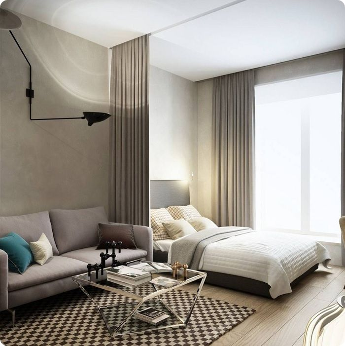Уютная спальня в спокойных тонах, объединённая с гостиной.