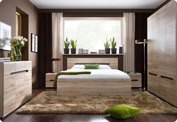 Спальня в экологичном стиле в спокойных тонах.